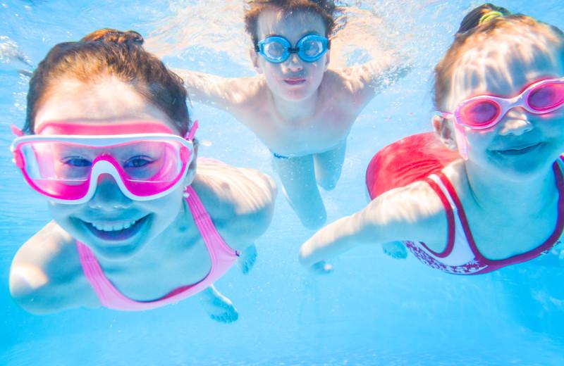 Family swimming at Kapilana Resort.