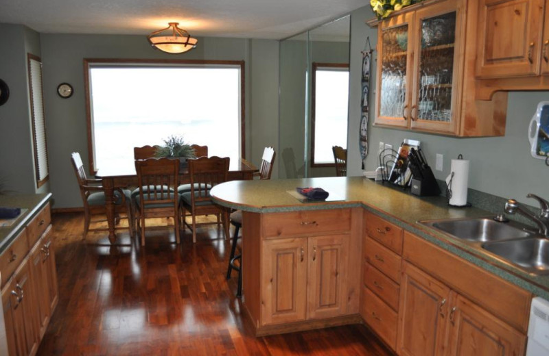 Unit 40 kitchen at Cavalier Beachfront Condominiums.
