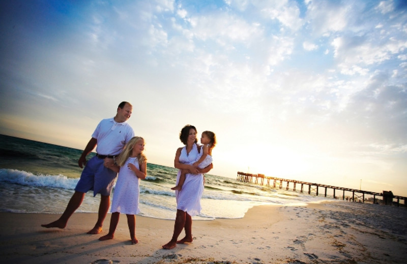 Family walking on the beach at Newman-Dailey Resort Properties, Inc.