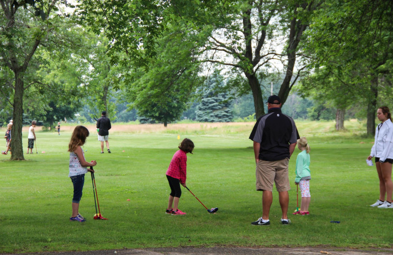 Golf lessons at Coachman's Golf Resort.