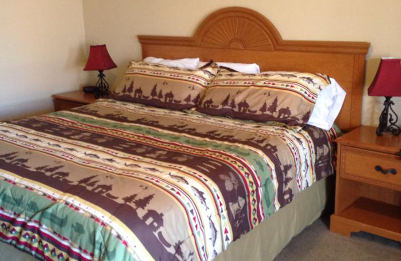 Guest bed at Hochatown Country Lodge.