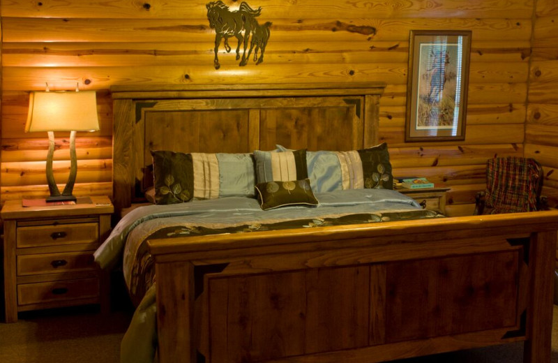 Cabin bedroom at A To Z Guest Ranch.