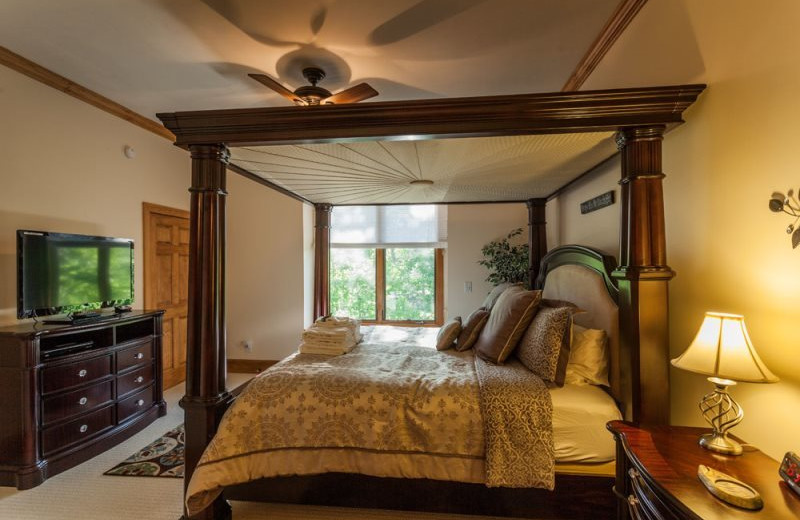 Cabin bedroom at Mountain Oasis Cabin Rentals.