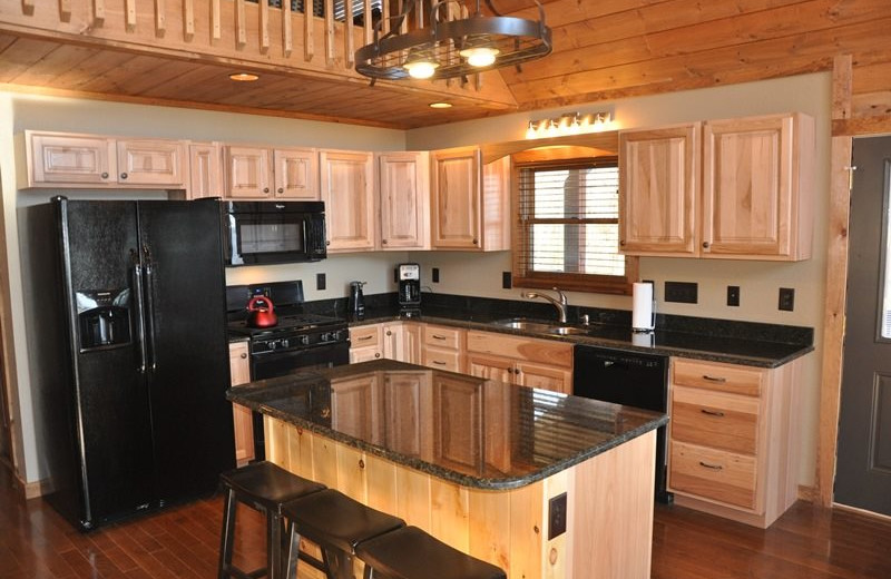 Cabin kitchen at Great Smokys Cabin Rentals.