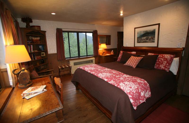 Cabin bedroom at Tumbling River Ranch.