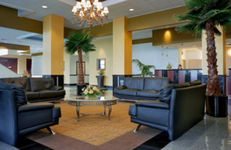 Wait for the complimentary hotel shuttle in the lobby seating area at Best Western Baltimore.