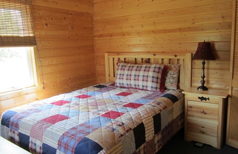 Cabin bedroom at Kec's Kove Resort.
