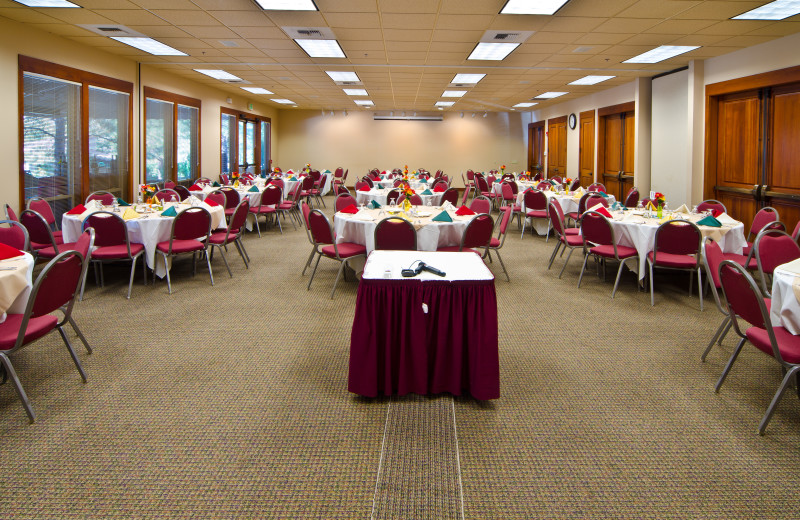 Winters Hope, set for group dinner, floor to ceiling window at Mount Bachelor Village Resort.