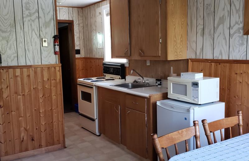 Cabin kitchen at Sejour Kouchibouguac Resort.