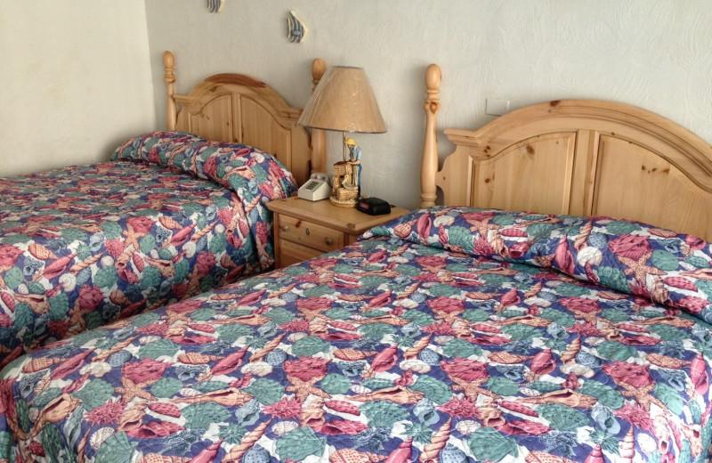 Guest beds at Fountain Beach Resort.