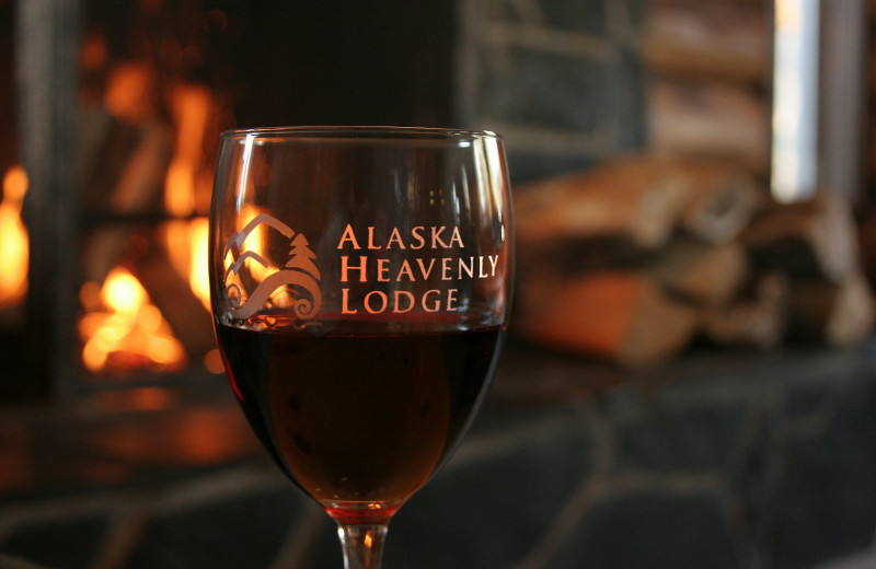 Wine in front of the fireplace Alaska Heavenly Lodge.