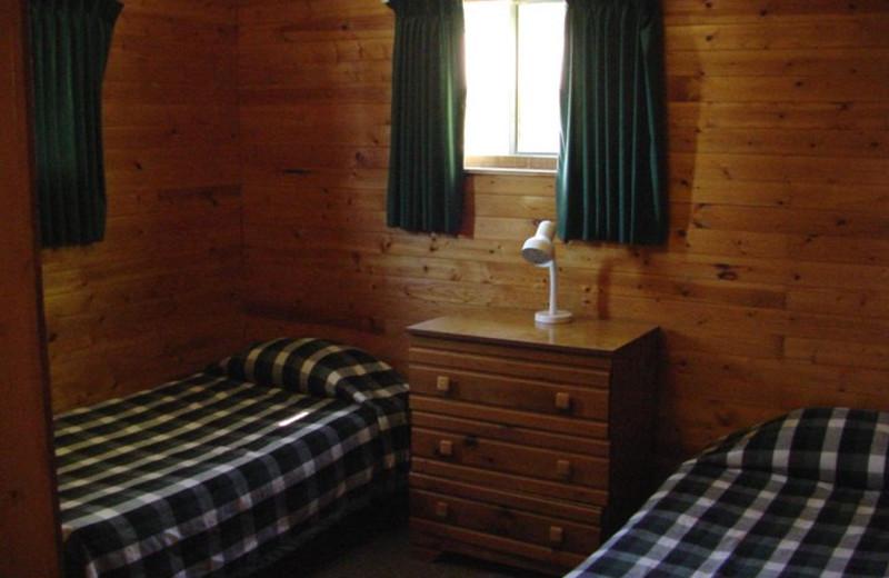 Cabin bedroom at Pipestone Point Resort.