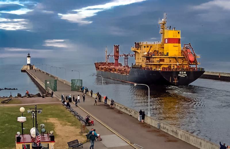 Ship passing through canal at South Pier Inn.