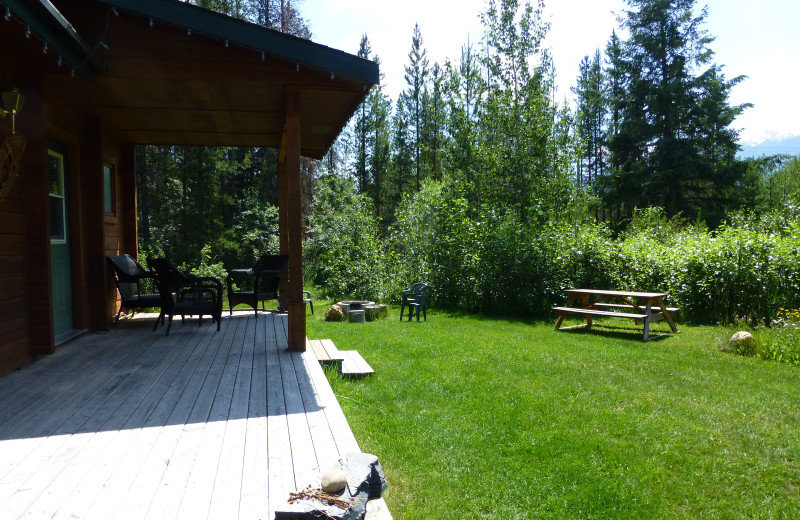 porch and picnic area at the Pine cabin, Mica Mountain Lodge & log cabins & side by side ATV tours