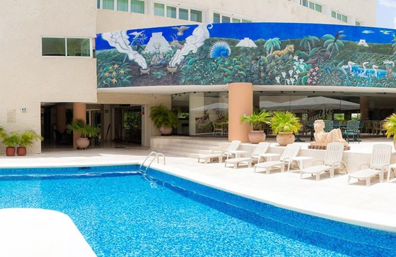 Outdoor pool at Hotel Los Aluxes.