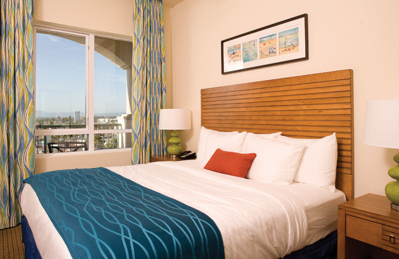 Guest bed at Wyndham Oceanside Pier Resort.