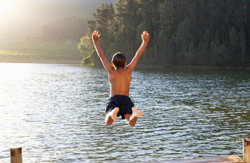 Jumping in lake at Nitschke's Northern Resort.