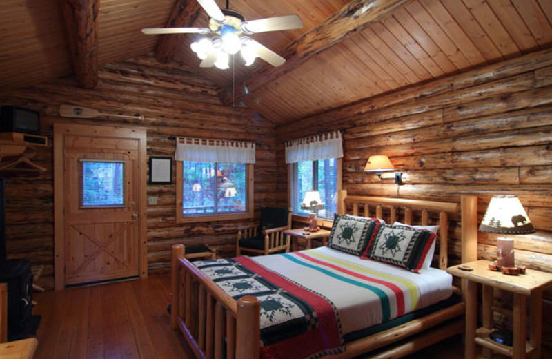 Cabin bedroom at Silverwolf Log Chalet Resort.