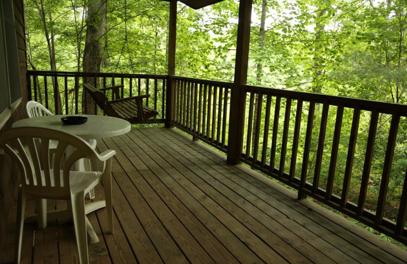 Covered porch w/swing on one of our Cupid's Hideout Cabins.