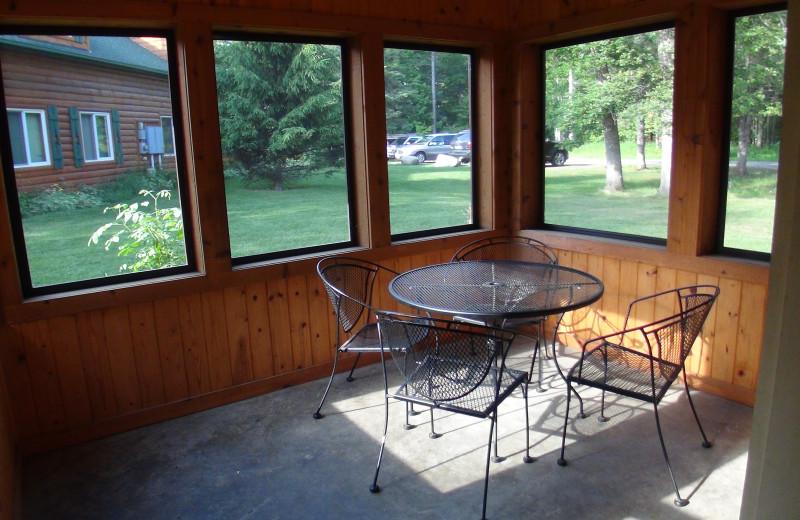 Cabin porch at Woodland Beach Resort.