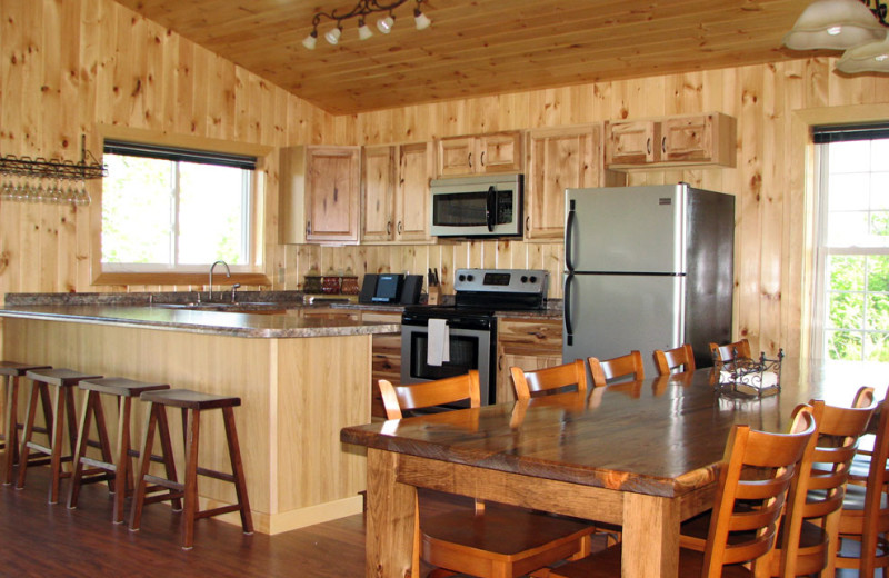 Cottage kitchen and dining table at Angel Rock Waterfront Cottages.