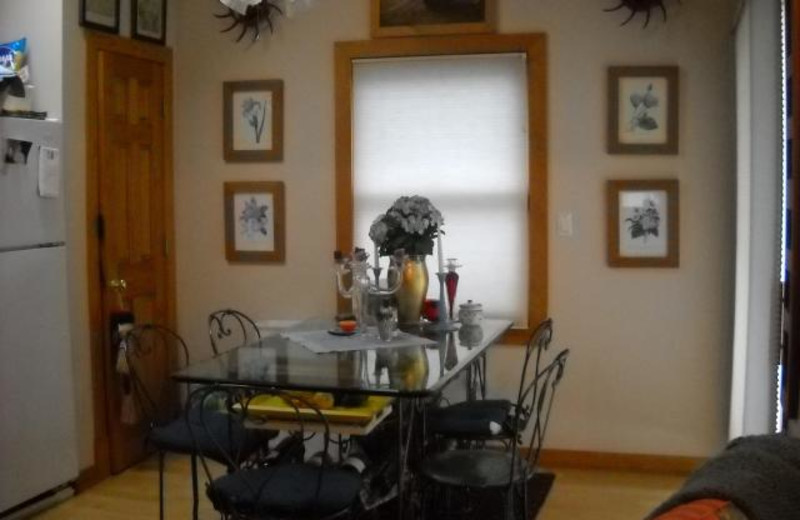 Vacation rental dining room at Beach Combers Vacation Rentals.
