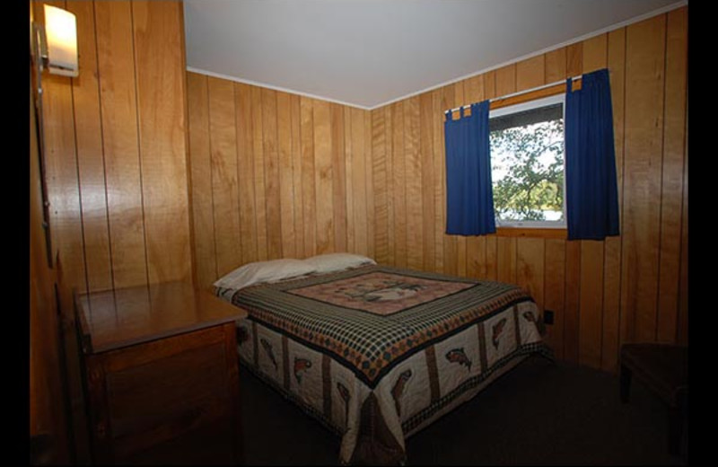 Cabin bedroom at Isle O' Dreams Lodge.