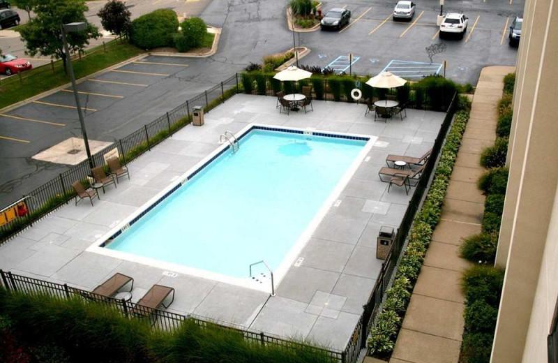 Outdoor pool at Hampton Inn Detroit-Northville.