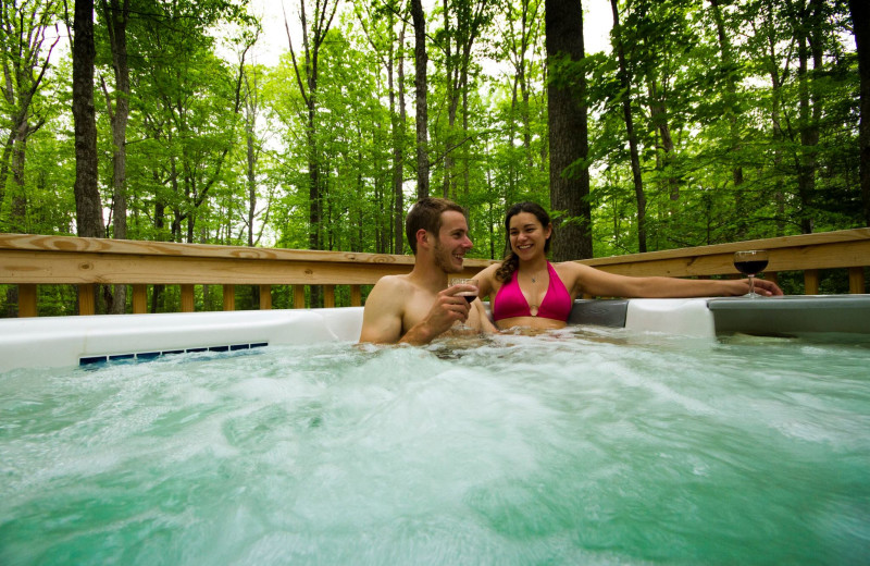 Cabin hot tub at Country Road Cabins.