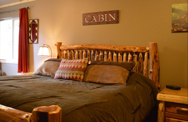Cabin bedroom at Summit Lake Lodge.