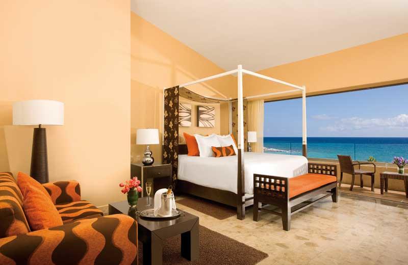 Guest room at Dreams Puerto Aventuras Resort & Spa.