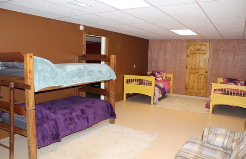 Guest bedroom with bunk beds at Saddleback Lodge.