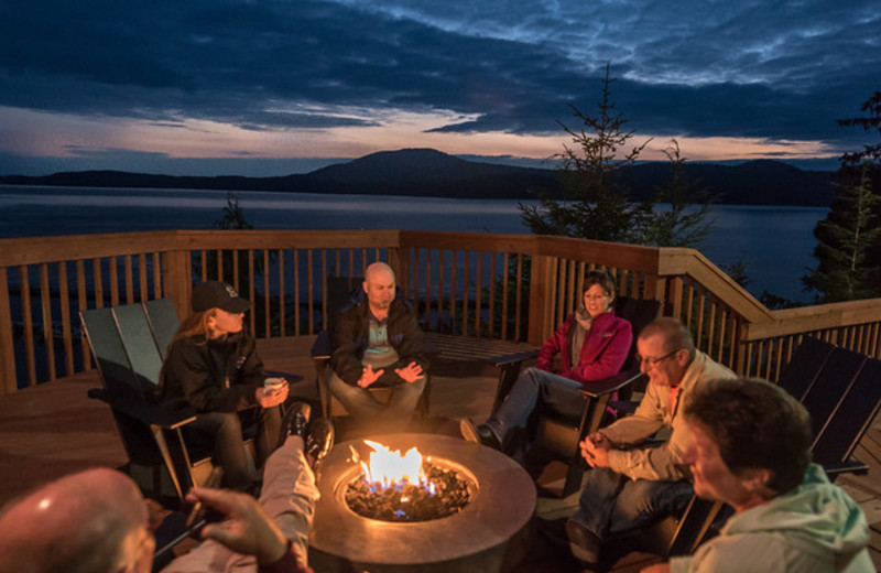 Relaxing by the fire on the deck overlooking the bay at Salmon Falls Resort