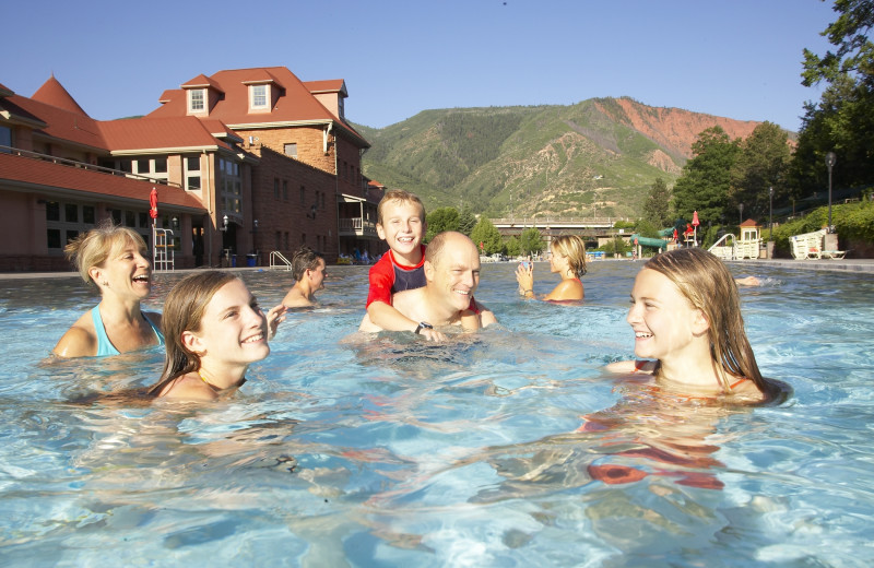 Family swimming in springs at Glenwood Hot Springs.