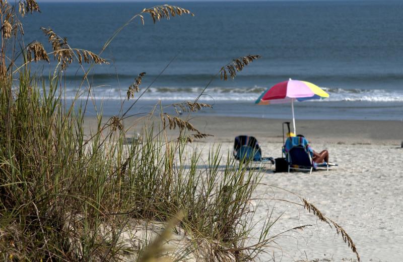 Relaxing on the beach at Ocean Isle Inn.