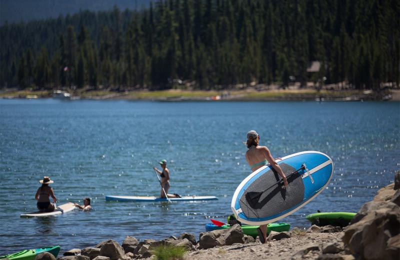 People on beach at Elk Lake Resort.