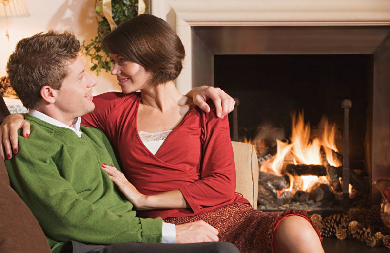 Couple by the fire at Eaglewood Resort & Spa.