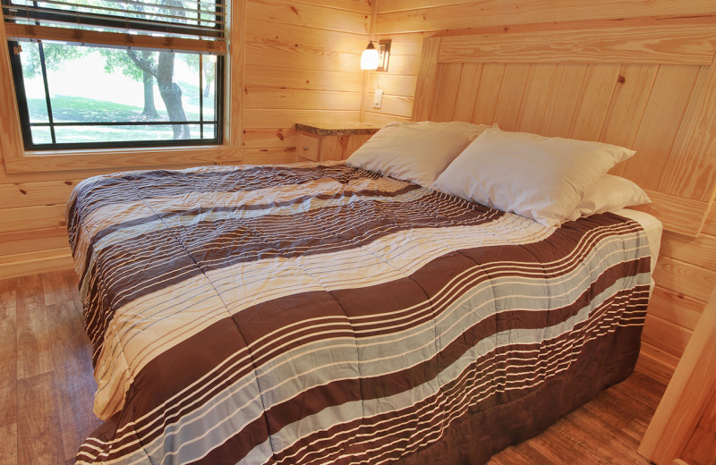 Cabin bedroom at Yogi Bear's Jellystone Park™ Guadalupe River.