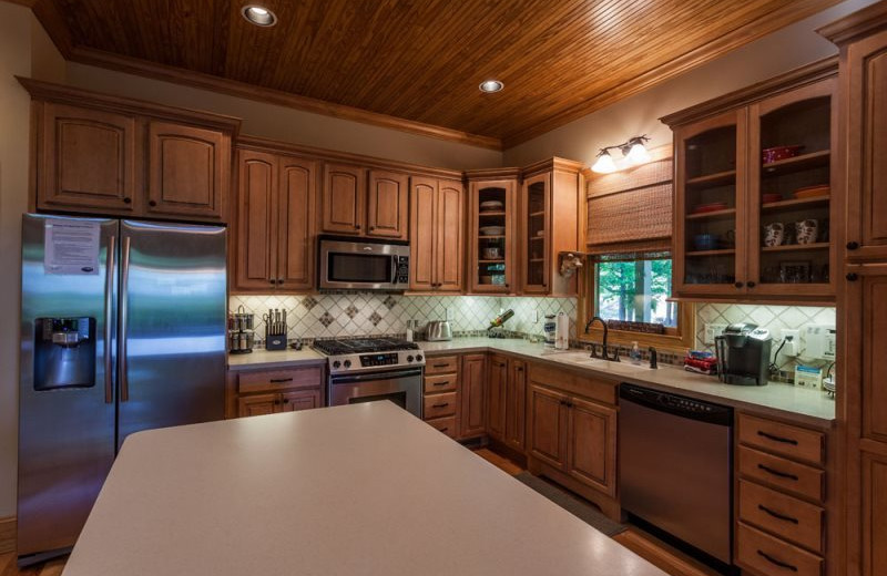 Cabin kitchen at Mountain Oasis Cabin Rentals.