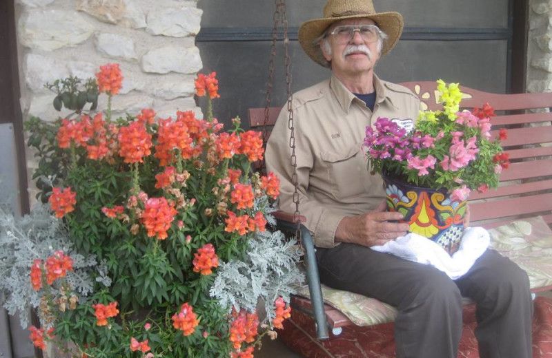 Man sitting with flowers at Cliffview Resort.