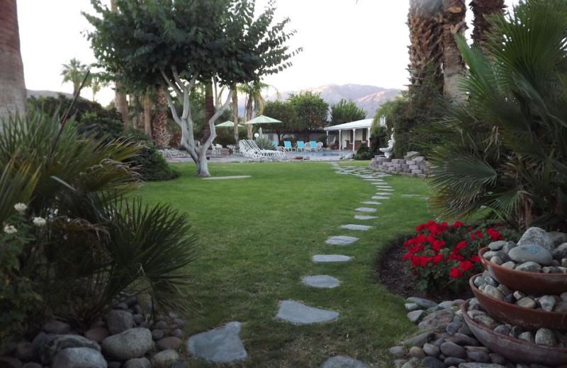 Exterior view of Alpine Gardens Hotel.