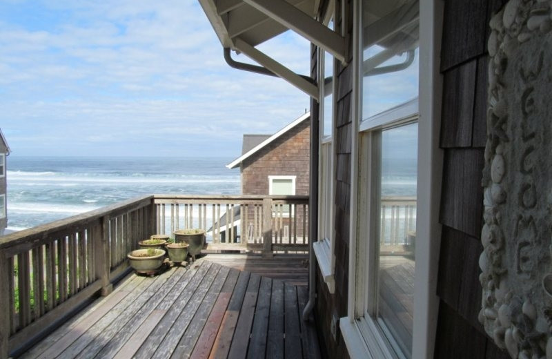 Vacation rental deck at Bella Beach Property Management.