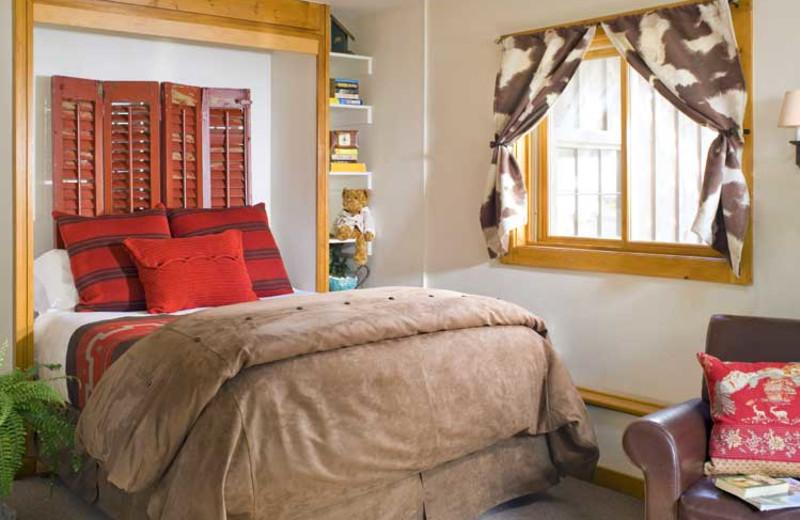 Cabin bedroom at O-Bar-O Cabins.