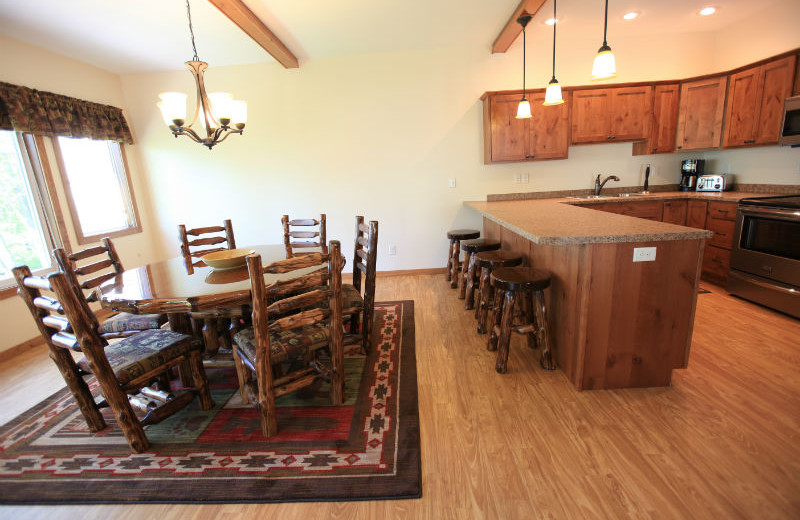 Dining area and kitchen at East Silent Lake Vacation Homes.