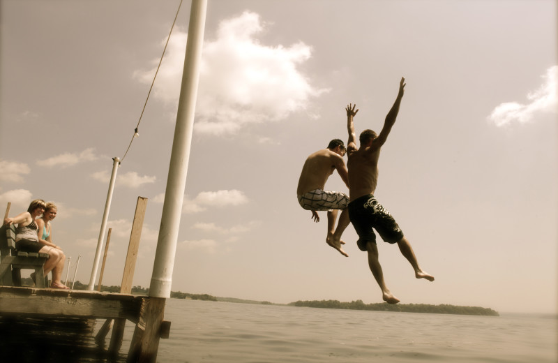 Jumping in lake at Southview Cottages Resort.