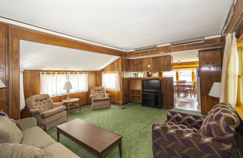 Cottage living room at Riverbank Motel & Cabins.