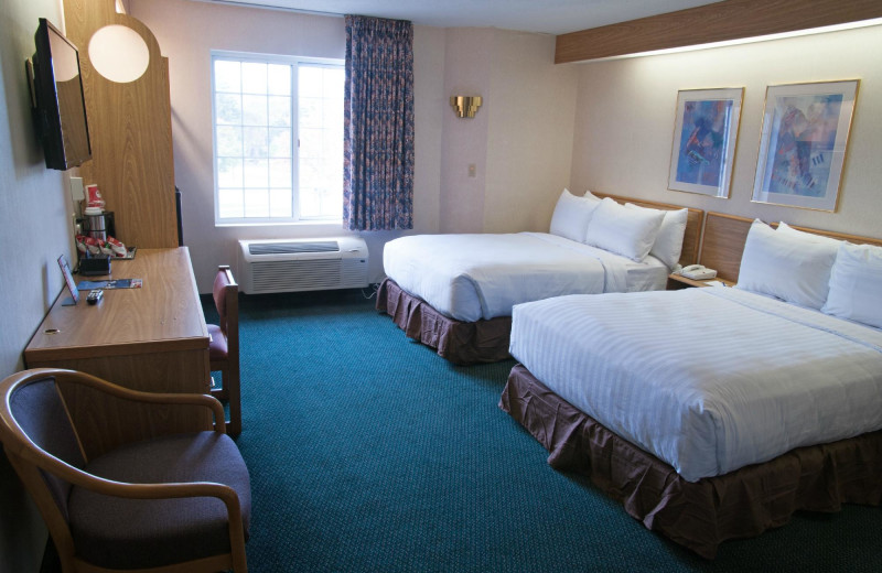 Guest room at Charlevoix Inn & Suites.
