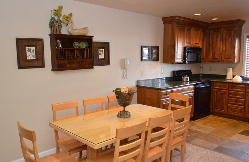 Rental kitchen and dining area at Frias Properties of Aspen - Alpenblick #13.