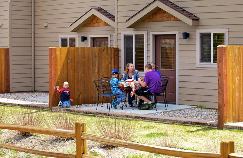 Family on patio at Beaver Brook on the River.