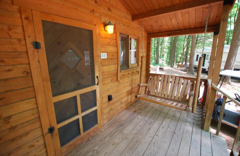 Cabin deck with swing at Lake Ridge Resort.